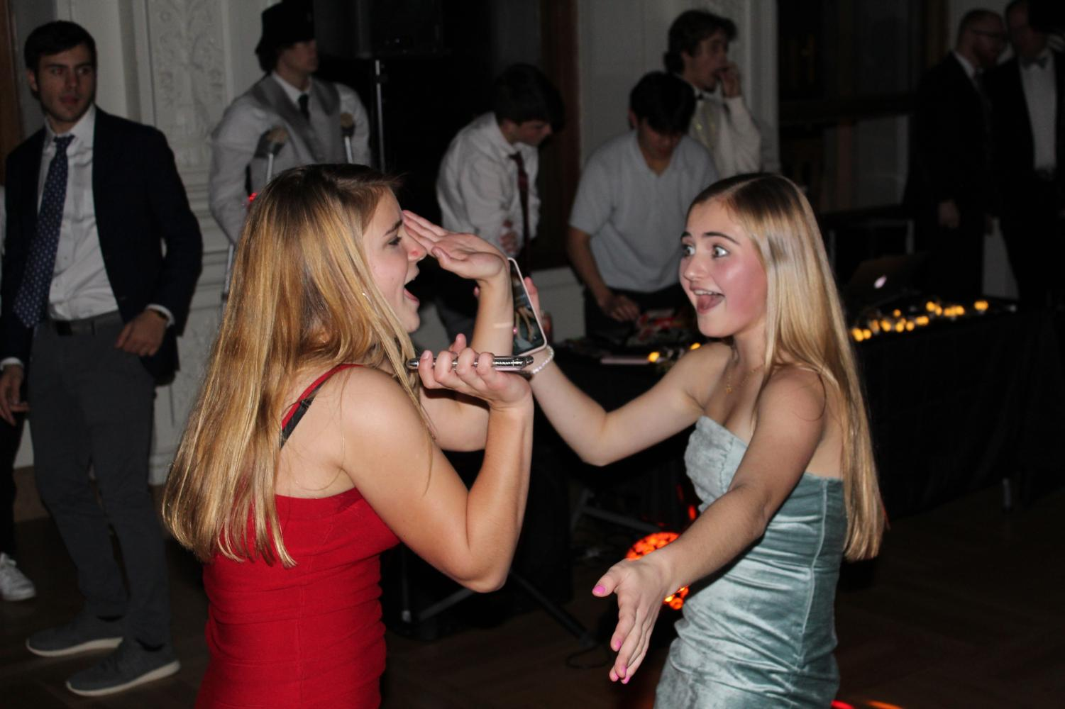 Sophomores Avery Stout and Paige Retajczyk dance at the Winter Formal. The dance was scheduled a week before the sophomore class leaves for Convent & Stuart Hall's annual President's Costa Rica Trip.