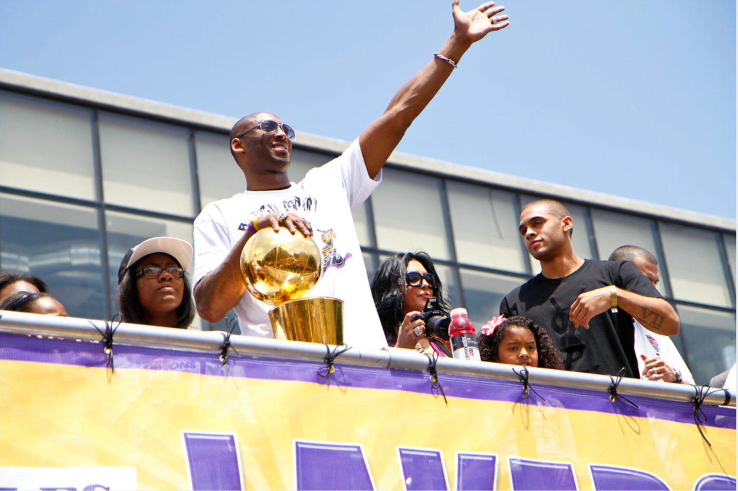 Kobe Bryant waves to fans during the Los Angeles Lakers' 2010 Championship Parade. Bryant won five NBA championships throughout his career.