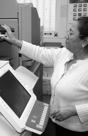Employee in printing office appreciates work