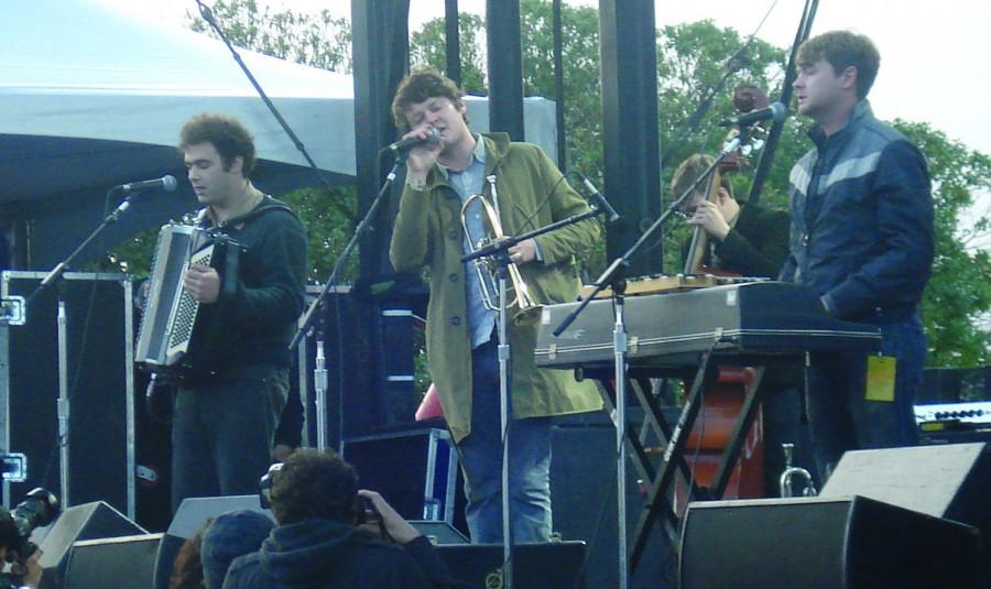 Beirut frontman Zach Condon (center) sings alongside accordion player Perrin Cloutier (left) and keyboard player Paul Collins (right) at Treasure Island Music Festival on Sunday, Oct. 18. Taking the Bridge stage just before sundown, Beirut performed with a trumpet, an accordion, sousaphone and other atypical rock instruments.