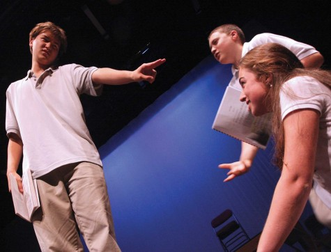 "Senior Noel McCann (left) rehearses a scene from Inherit the Wind with junior Christian Gehrke and sophomore Maddie Kelley. Based on the Scopes ""Monkey"" Trial, the play celebrates the 200th anniversary of the publishing of Charles Darwin's On the Origin of Species. Performances are scheduled for Nov. 19–21 in the Syufy Theatre."
