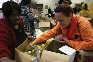 Volunteers Doris Greene and Pamela Newman help package food. The San Francisco Food Bank distributes food to over 600 Bay Area community programs.