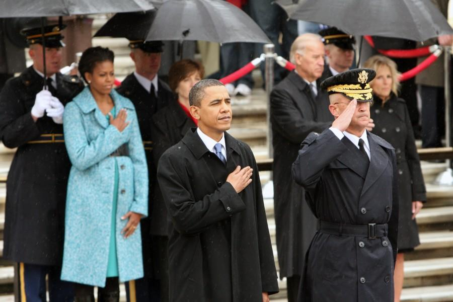 Obama and the crowd place their hands across their hearts while the Star Spangled Banner is sung. The National Anthem was performed in an soft, slow instrumental arrangement before the president's speech. Photo: Ina Herlihy