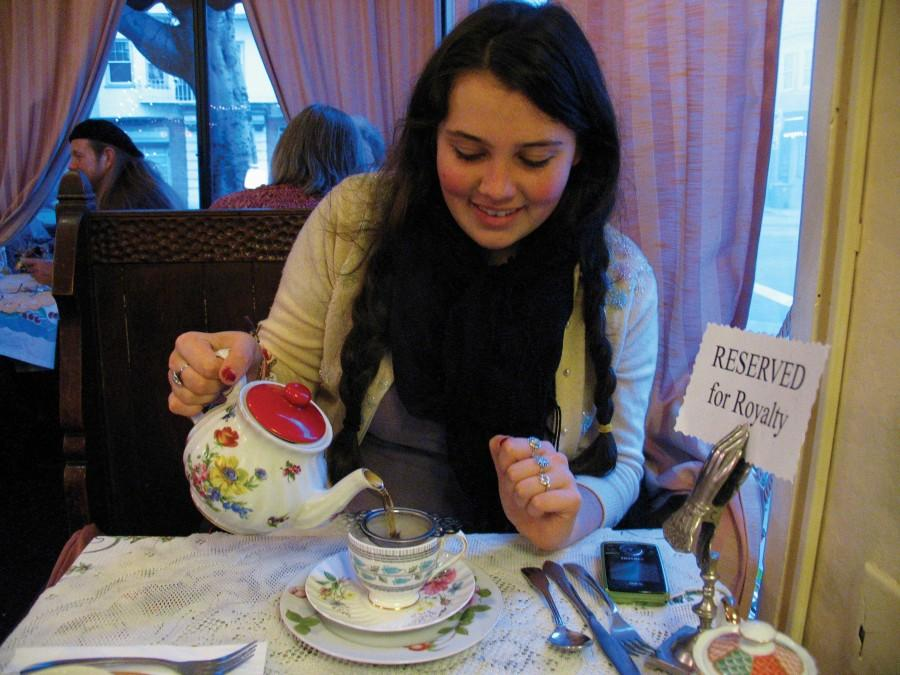 """Junior Frankie Incerty pours tea at Lovejoy's Tea Room. Although the sign says """"Reserved for Royalty,"""" Lovejoys welcomes tea drinkers of all ages — specializing in warm scones and dainty sandwiches with the crusts cut off. ANJALI SHRESTHA 