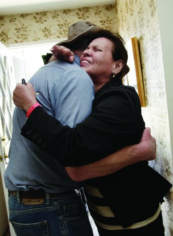Debra Cresci, right, hugs her neighbor, Steve Matisek, upon returning home to find her San Bruno, California home undamaged on Sunday, September 12, 2010, following the aftermath of a huge natural gas explosion last Thursday. (Gary Reyes/San Jose Mercury News/MCT)