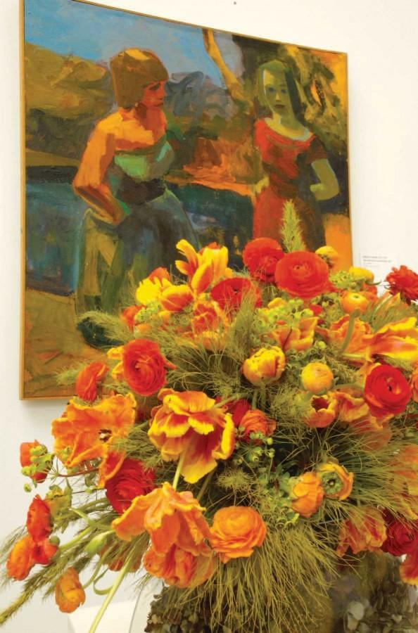 """Red and orange blooms are showcased at Bouquets to Art 2006 at the de Young museum in imitation of William Brown's """"Two Figures in a Landscape."""" The exhibit displays flower arrangements inspired by art throughout the galleries. ANDREW FOX 