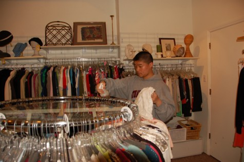 Anjali Shrestha | the broadview. Freshman Patrick Wong sorts clothes at Seconds to Go as a volunteer. CSH and SHHS students can get community service hours working at the store located on Filmore St.