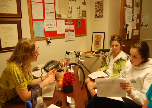 Katy Hallowell | the broadview.  Juniors Taylor Carlson and Solana Boboschi sit in Kievlan's office and discuss grades they recieved on an english paper. Kievlan tutors students in all subjects, and helps them to build effective study habits.