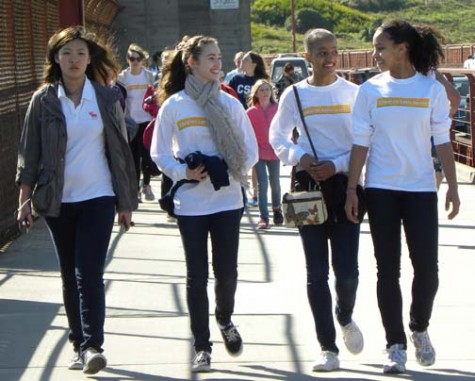 Freshmen Rachel Fung, Christina Braa, Lisa Cameron and Dervla Carey-Jones sport their Walk for Uganda long-sleaved shirts. REBECCA LEE | The Broadview
