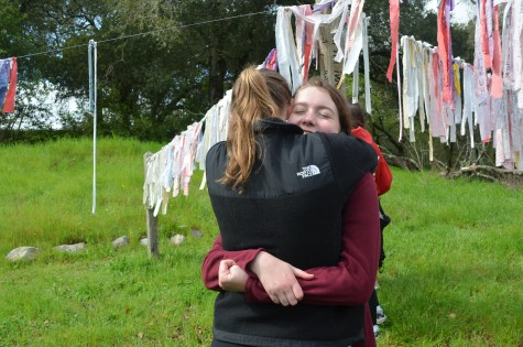 Seniors Sarah Hegarty and Brooke Thomas take a moment to embrace one another at the Peace Pole in Bishop's Ranch.  SOPHIA REDFERN | The Broadview