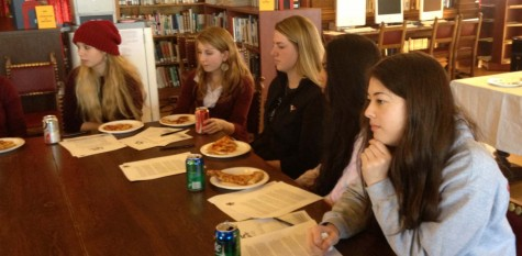 Freshman Julia Praeger, juniors Francesca Dana, Alyssa Viscio and senior Gina Domergue (left to right), interview a candidate for head of school. Four candidates were interviewed over the course of the month.
