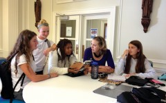 Christina Berardi, Alexandra Wood, Zoe Baker and Franny Eklund (left to right) meet with Academic Support Director Patricia Kievlan in the Center during their free period to discuss their Honors American Literature book