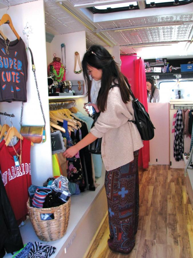 CES alumna Nina Huynh ('10) browses in one of the walk-in store trailers Too Self Boutique at the monthly Treasure Island Flea, always held on the last weekend of the month. The island is accessible by car and Muni.