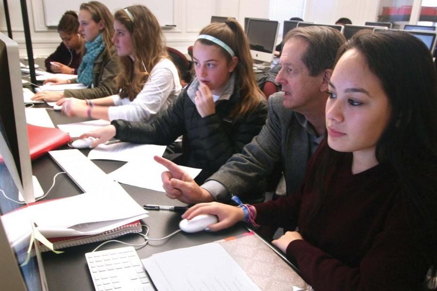 Alice Jones/The Broadview Java Juniors  Amanda Mah, Franny Eklund, Christina Berardi, Aoife Devereux and Zoe Baker (right to left)  work with computer programming teacher Doug Grant during class. The students are currently working on a banking program to track withdrawls balances and reports. ALICE JONES/The Broadview