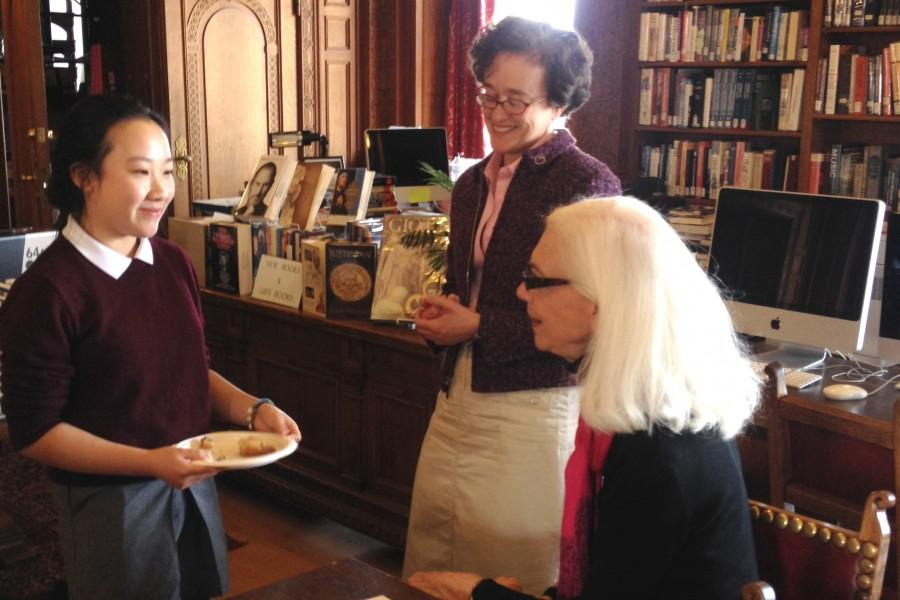 Sophomore Liana Lum, all-school winner of the Kate Chopin writing contest, talks with English teacher Julia Arce and head judge Constance Solari during a reception in the library.