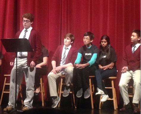 Senior Thomas Egan recites an original poem at the annual Poetry Festival. The Festival's theme this year is