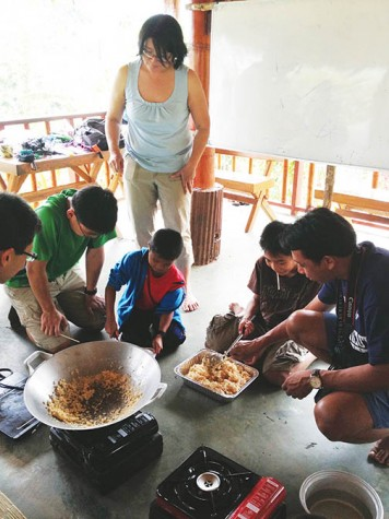 Taiwanese children make rice cereal and marshmallow treats for the first time with junior Kathryn Yu and her volunteer group. Yu traveled with Grace Covenant Church to work in schools.