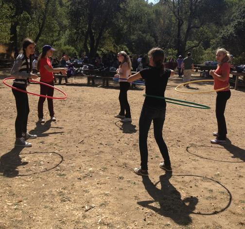 Sophomores hula hoop during free time at today's retreat at China Camp State Park in San Rafael.