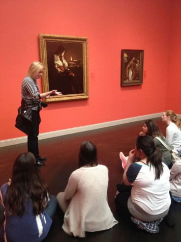 The AP Art History class observes and analyzes the Penitent Magdalen by Georges de la Tour at the Los Angeles Country Museum of Art. The class traveled down to Los Angeles to visit six museums before taking the AP test.
