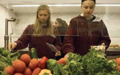 Juniors Anneka Dorresteyn and Katherine Burkett customize their salads from the salad bar.
