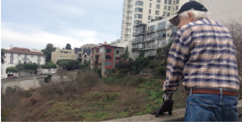 Cow Hollow resident Udo, who declined to give his last name, walks up Larkin street to get a view of the bay. The Reservoir on Larkin street will be renovated within the next three years and the new park opens in 2018.