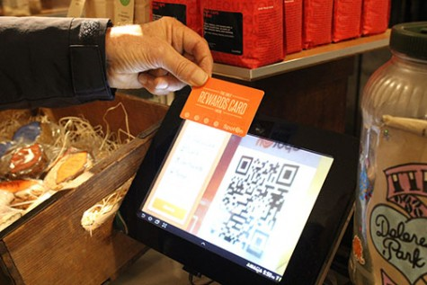Steve Nuzzo scans the QR code on the back of his SpotOn card to earn re- wards at the Dolores Park Cafe. Retailers are moving away from punch cards to digital loyalty programs.