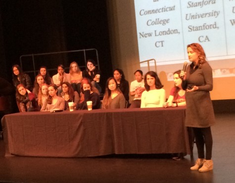 College Counselor Rebecca Munda introduces the panel speakers before seniors ask questions.
