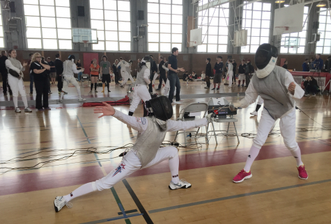 Sophomore Bea Gee lunges at her opponent during a fencing match. Rena Gee| with permission