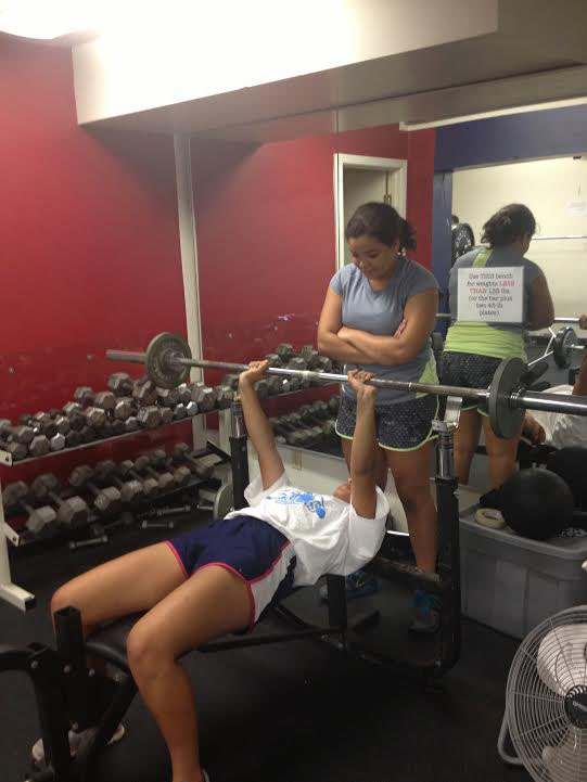 Junior Jillian Cardamon and sophomore Gia Monachino lift weights at Stuart Hall High Schools weight room during a track practice.