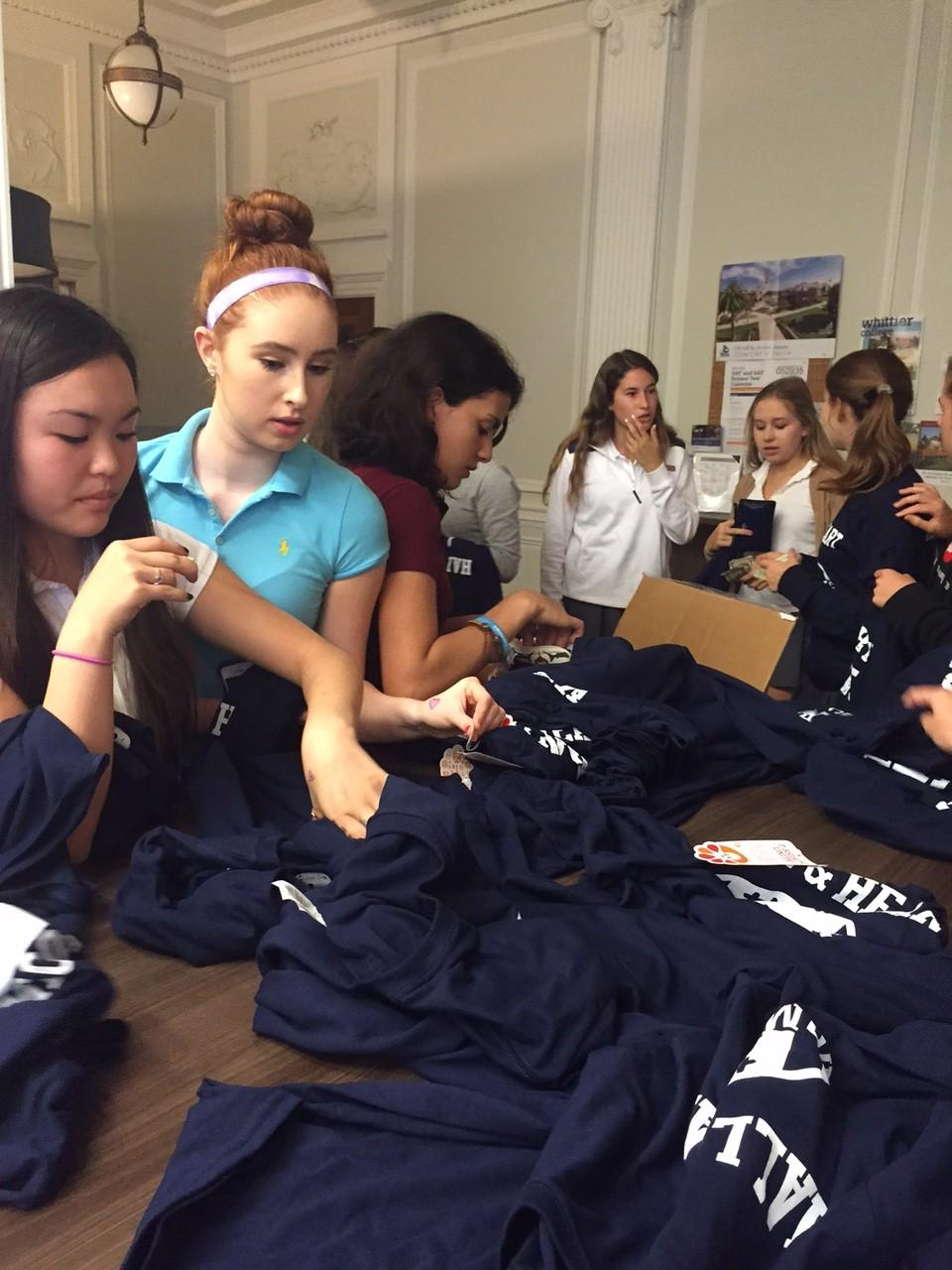 Students purchased shirts for this Saturday's Homecoming football game. More shirts will be available for sale tomorrow in the Center.