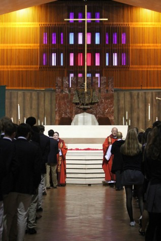 Faculty and high school students line up for communion. Blessings were also offered to students who did not wish to receive communion.