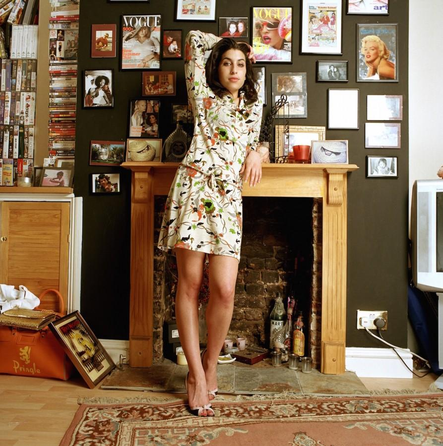 Winehouse posed at her first apartment in Camden Town, England where she moved to pursue her musical career in 2004, following the success of her hit album Frank.