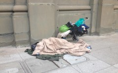 One of San Francisco's 6,686 known homeless resident sleeps on Webster at California Street, part of the designated walking route between CSH and Stuart Hall HS, on Monday morning. Students are getting involved with helping homeless individuals through volunteer work and on-campus programs.