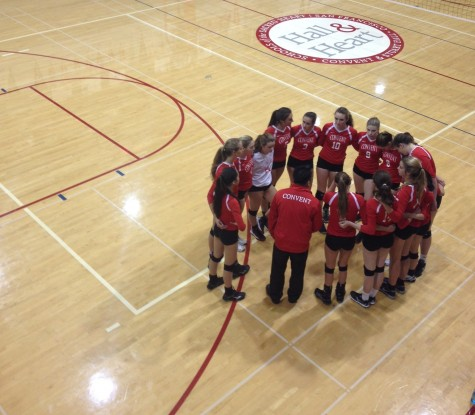 The varsity volleyball team huddles up before the game begins. The game was played against Marin Academy.