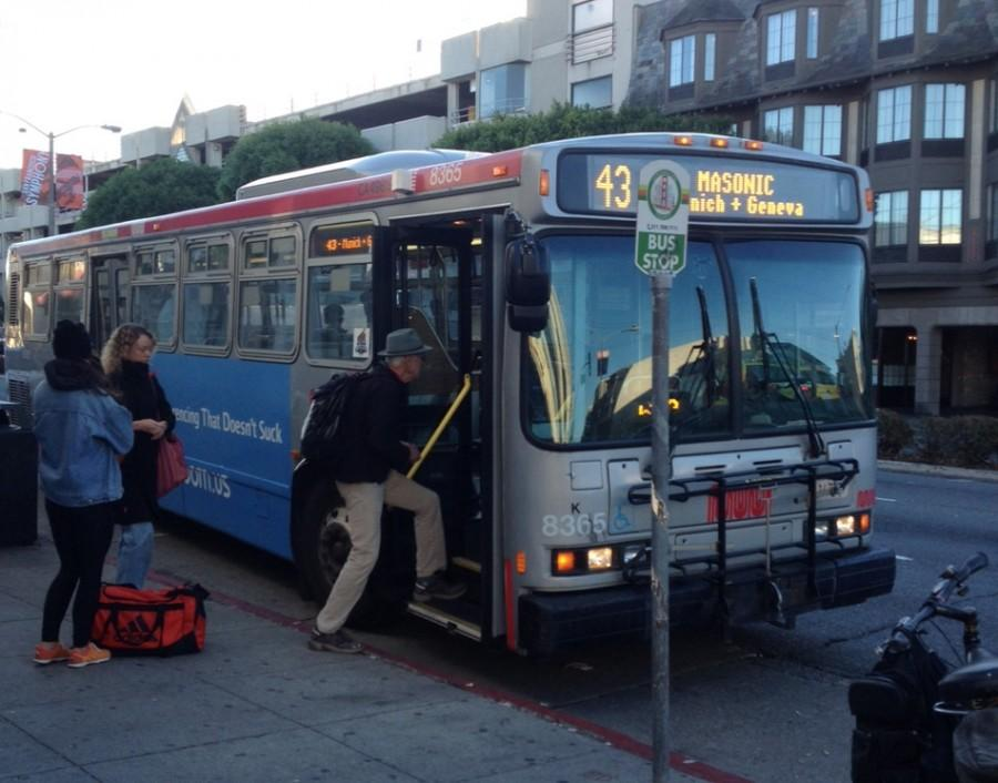 A woman waits on Lombard Street for the 4 bus. Muni plans to announce new routes to increase efficiency in early 2016.