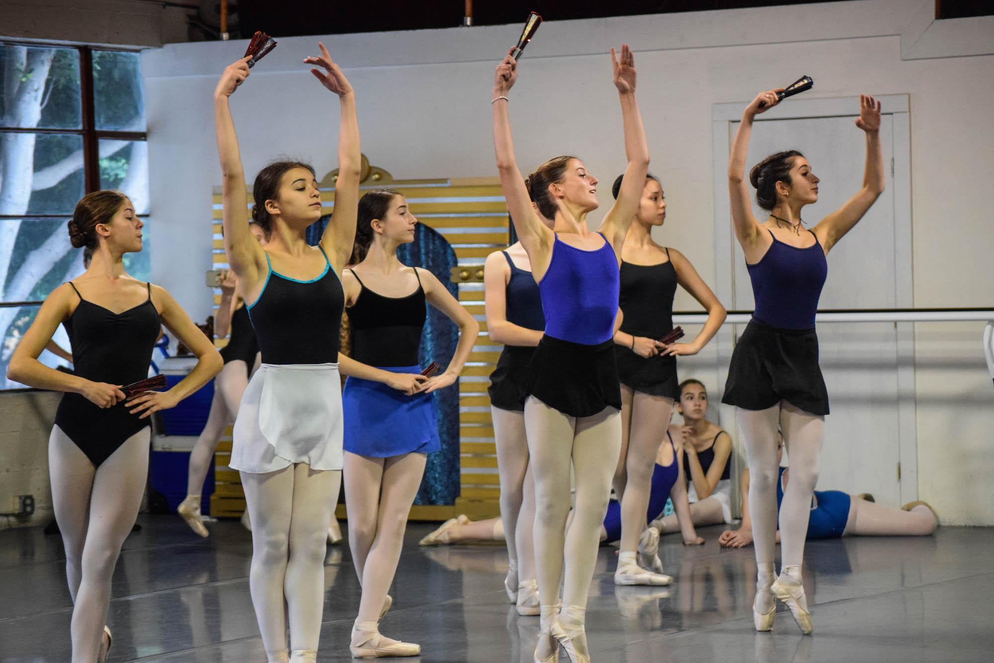 Freshman Wellsley Cohen dances en pointe with fellow ballerinas in the City Ballet Company in preparation for an upcoming performance of the iconic ballet
