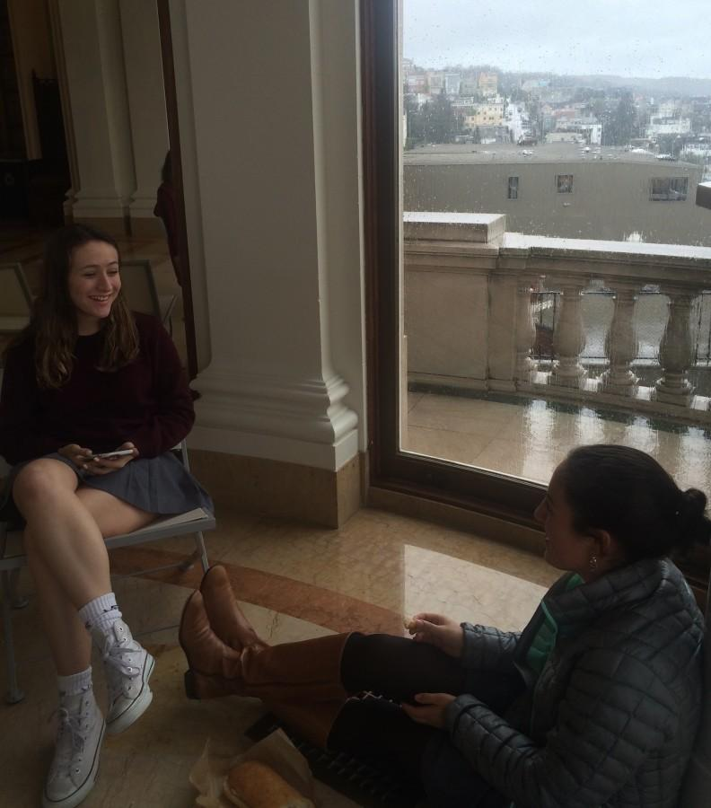 Juniors+Olivia+Hoekendijk+and+Bella+Kearney+eat+lunch+together+in+the+Belvedere+overlooking+the+soaked+city.+Rain+collected+and+flooded+in+the+balcony+area+outside+the+window.+