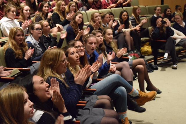 Seniors applaud an essay winner during the Kate Chopin Writing Contest. The judges were the English department and Spanish teacher Rikki Garcia.