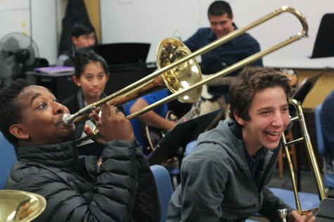 Stuart Hall High School freshmen Donovan Warren (left) and Jackson Daecher (right) prepare for jazz band while sharing a laugh.