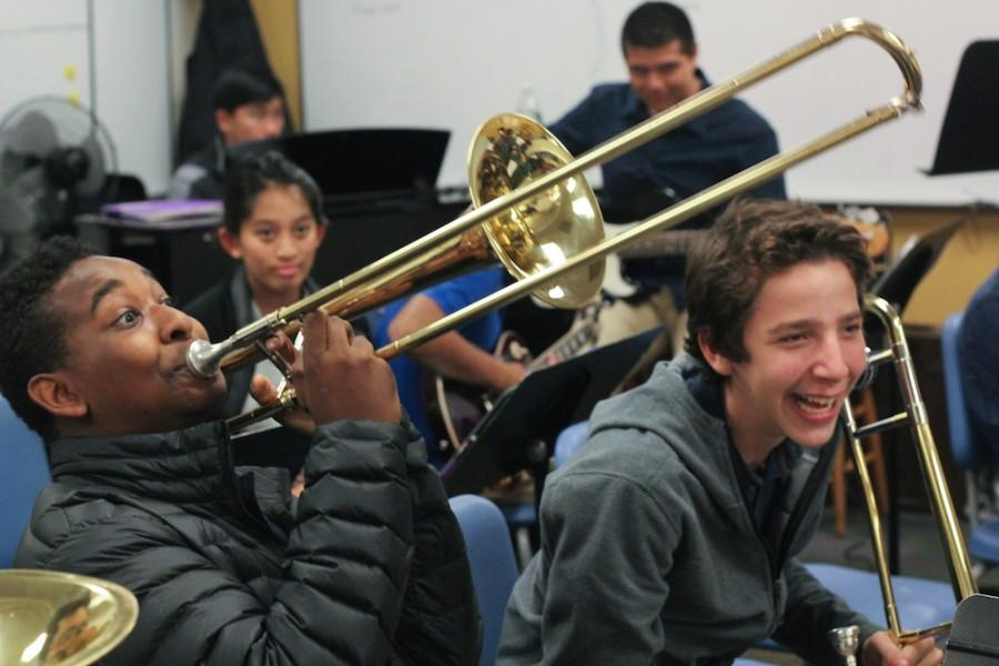 Stuart Hall High School freshmen Donovan Warren (left) and Jackson Daecher (right) prepare for jazz band while sharing a laugh.