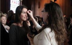 Sophomore Lucia Escalza receives ashes on her forehead from senior Maxine Hanley. The Ash Wednesday chapel included scripture reading and student testimonials.