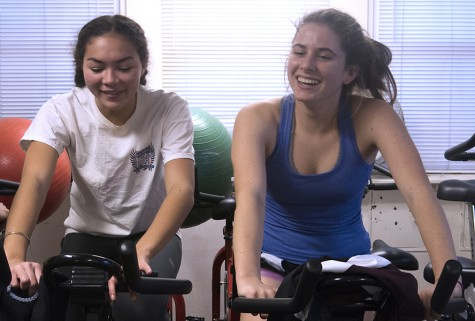 Juniors Hailey Long and Katie Newbold (left to right) cycle during winter conditioning practice. Ahletes also weight lift, run and do core exercises.
