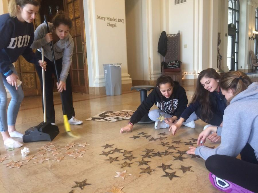Junior Class students design the stars for the cardboard Eiffel Tower that is being assembled for the Father Daughter Dance. The event is organized by Junior Student Council.