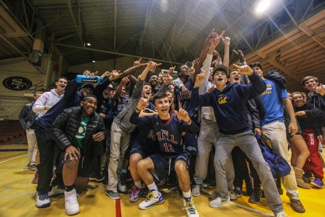 Stuart Hall High School students and basketball players pose for a photo after the basketball team won their game against rival University High School.
