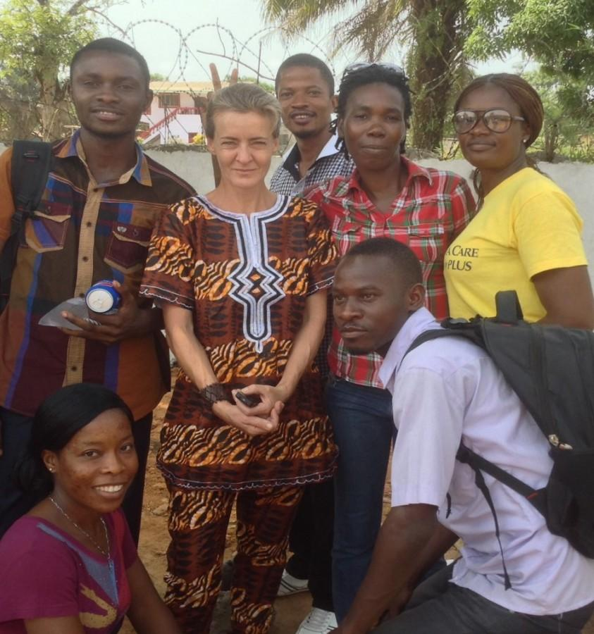 Former French and drama teacher Miriam Czech, who currently works with Doctors Without Borders, takes a photo with her health promotion team in Monrovia, Liberia. Czech has worked as a nurse, translator and radio operator for the organization.
