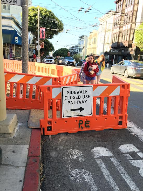 Convent Elementary students  maneuver around the closed sidewalk on their way to school this morning. The sidewalk closed last week and will remain closed until construction is finished.