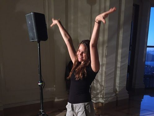 Senior Chloe Lovato strikes a pose during the rehearsal for the annual Simple Gifts Fashion Show. The event will be donating their funds to La Casa de las Madres, a shelter for domestic violence victims.