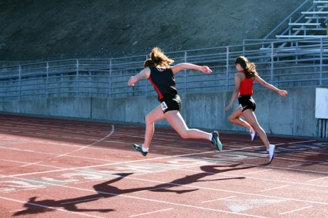 Track and field athletes jump their way through practice at Kezar Stadium.