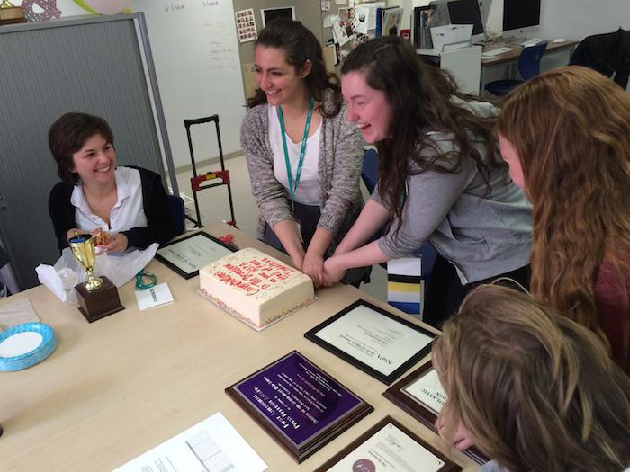 The Broadview staff celebrates their national recognition from the National Scholastic Press Association with a cake in the Publications Lab. The staff picked up the awards last week at the NSPA convention in Los Angeles, CA.