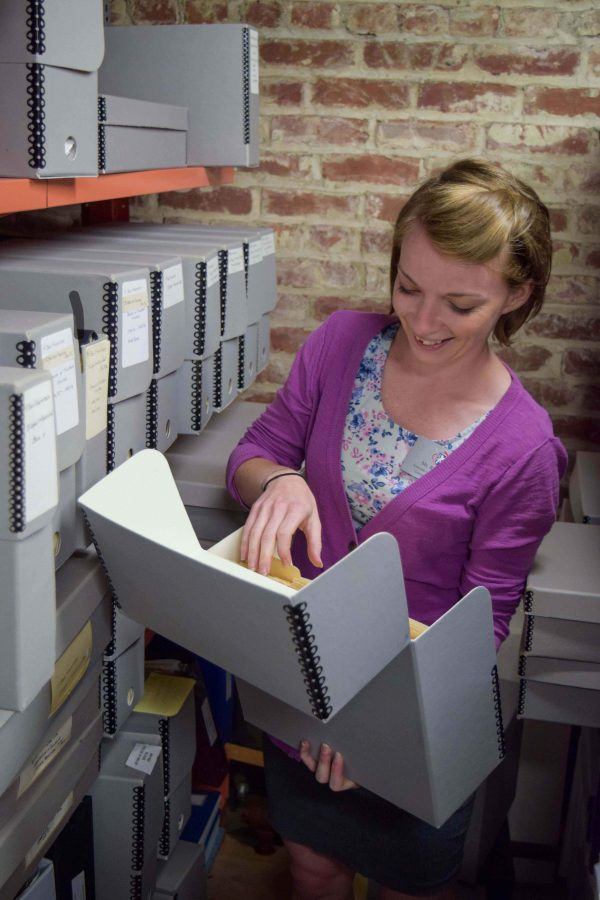 Associate Librarian Reba Sell sorts through documents in the Archives in the Grant House attic. The Archives contain  historical documents and old yearbooks.